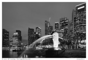 Merlion fountain and skyline at dusk. Singapore